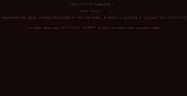 桌面壁纸由GandCrab 5.1设置,带有警告信息以及对赎金票据的参考